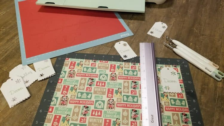 cutting out christmas gift tags