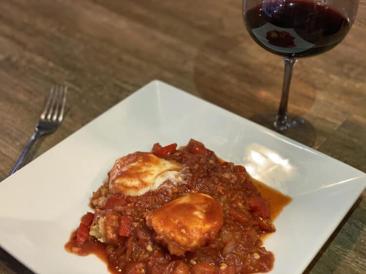 traditional shakshuka recipe on a polenta base