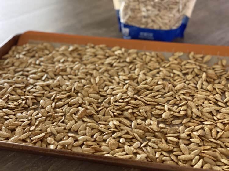 pumpkin seeds on cookie sheet