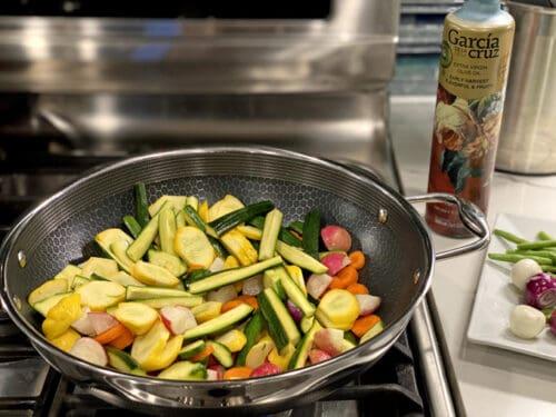 citrus veggie stir fry in hex clad wok pan