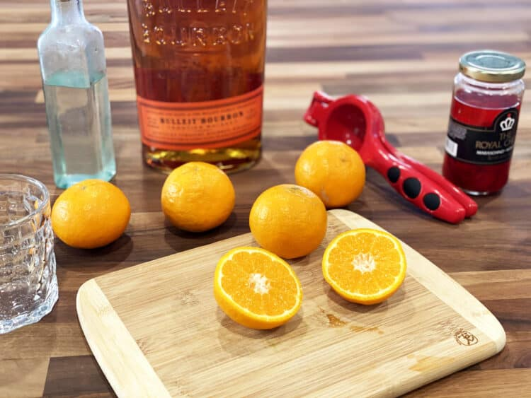 making a bourbon sour with tangerines