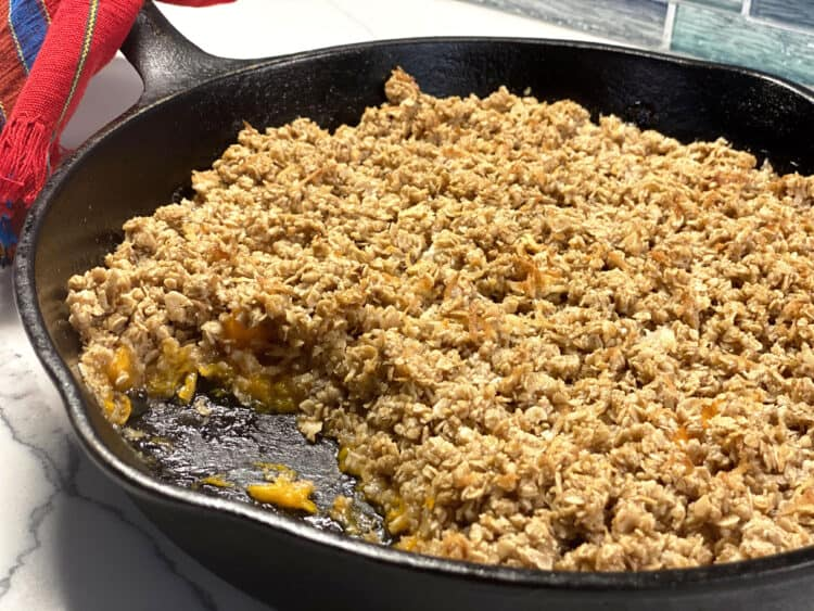 coconut apricot crumble in a cast iron pan